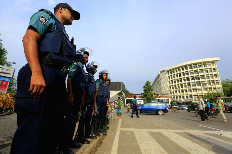 DHAKA, May 8, 2016 - Bangladeshi policemen stand guard on a street during a two-day strike in Dhaka, capital of Bangladesh, on May 8, 2016. A two-day nationwide shutdown called by Bangladesh ...