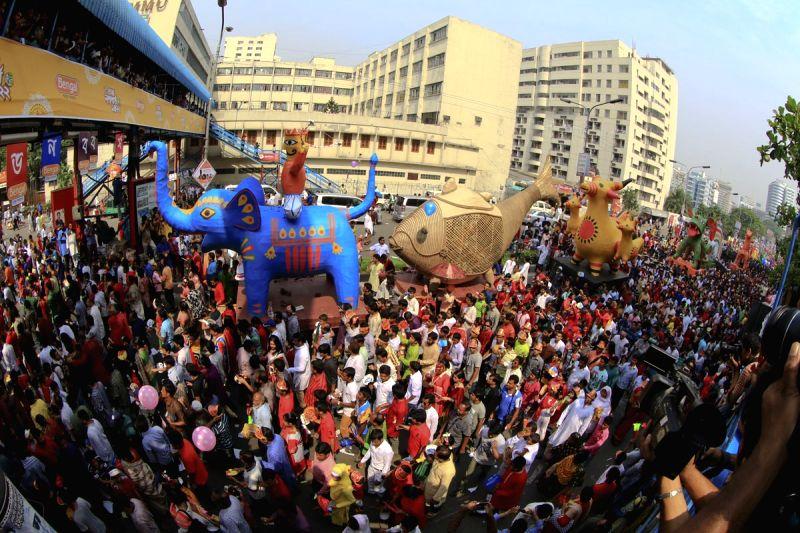 People join Mangal Shobhajatra, the traditional procession, organised by the Fine Arts faculty of Dhaka University on Pahela Baishakh in Dhaka on April 14, 2015.