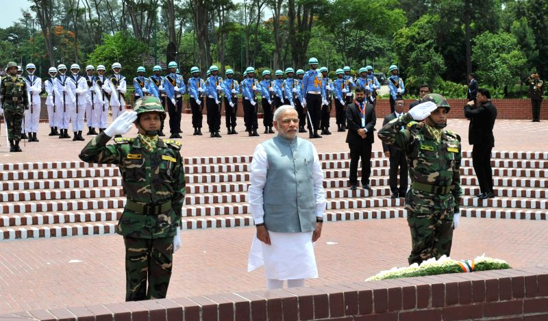 Prime Minister Narendra Modi pays homage to the martyrs, at the National Martyrs` Memorial, in Savar, Dhaka on June 6, 2015. - Narendra Modi