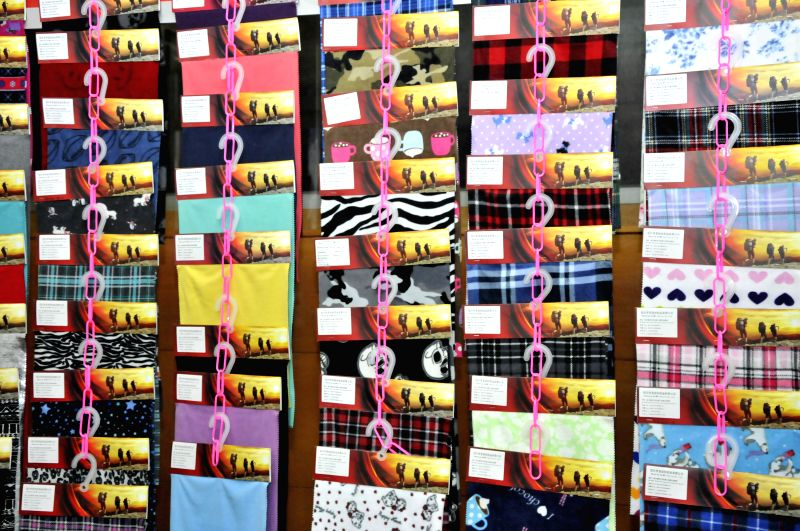 Cloth is displayed at a stall during the 15th Textech Bangladesh 2014 International Expo in Dhaka, Bangladesh, Sept. 3, 2014. The international exhibition on ...