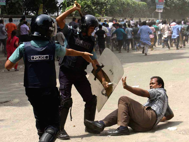 Policemen clash with protesters during the court appearance of Bangladesh Nationalist Party Chairperson and former prime minister Khaleda Zia in Dahka, Bangladesh, ...