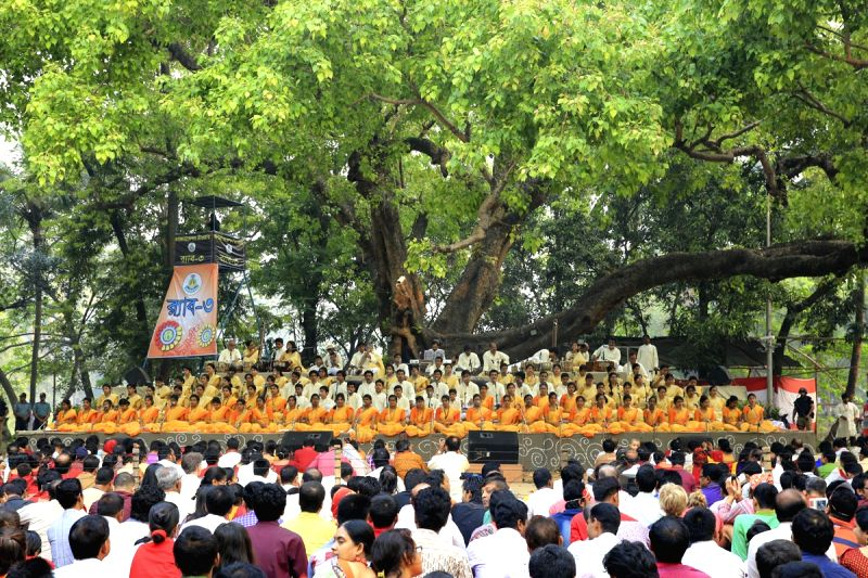 Singers perform during a programme organised to welcome the Bangla New Year - 1422 in Ramna Batamul of Dhaka on April 14, 2015.
