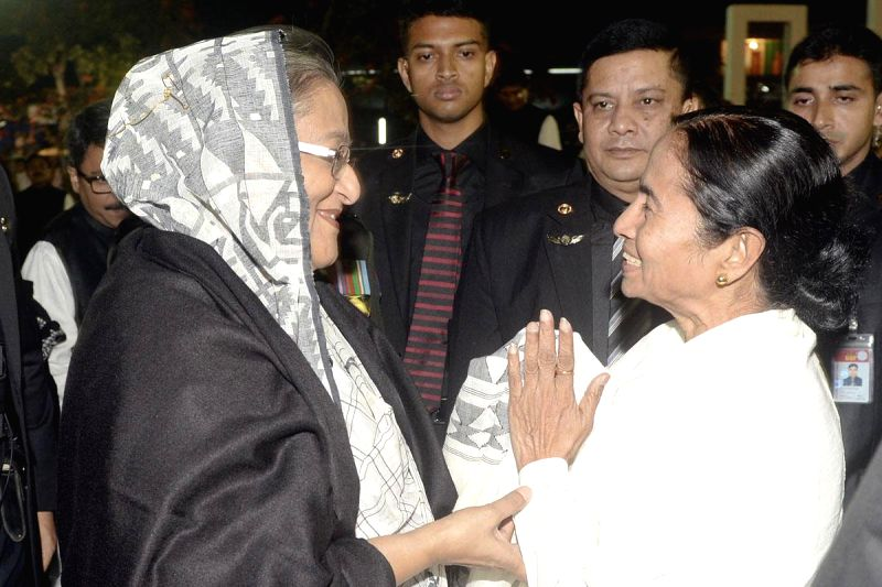 West Bengal Chief Minister Mamata Banarjee greets Bangladesh Prime Minister Sheikh Hasina at the Central Shaheed Minar in honour of the 1952 Language Movement martyrs in Dhaka, Bangladesh, on ...