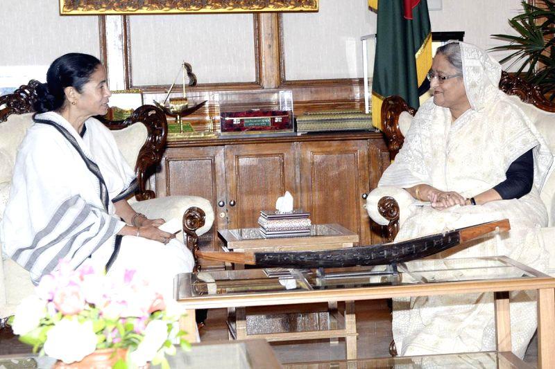 West Bengal Chief Minister Mamata Banarjee meets Bangladesh Prime Minister Sheikh Hasina at Ganabhaban in Dhaka, Bangladesh, on Feb 21, 2015.