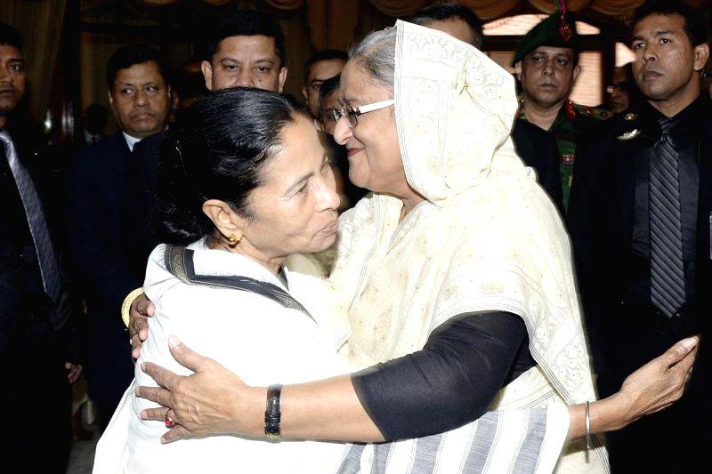 West Bengal Chief Minister Mamata Banarjee greets Bangladesh Prime Minister Sheikh Hasina at Ganabhaban in Dhaka, Bangladesh, on Feb 21, 2015.