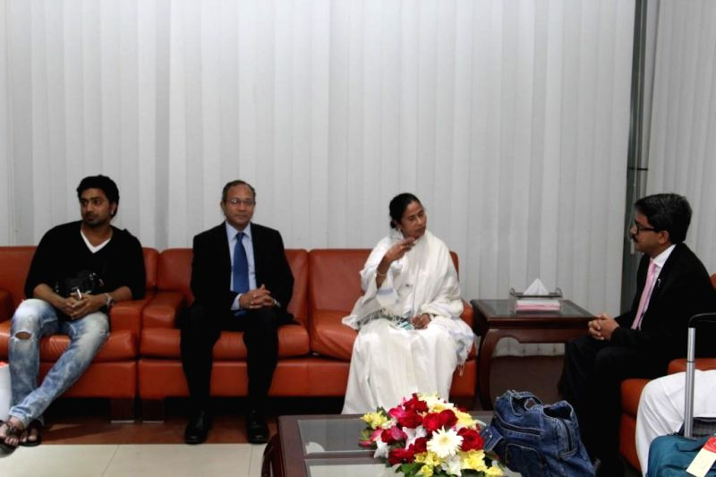 West Bengal Chief Minister Mamata Banerjee and actor turned politician Dev during their visit to Dhaka, Bangladesh on Feb 19, 2015. - Mamata Banerjee