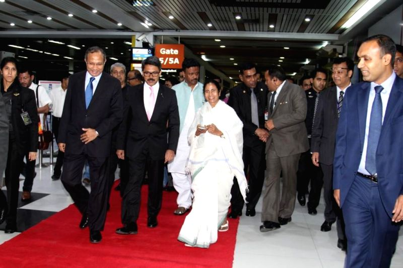West Bengal Chief Minister Mamata Banerjee  being welcomed on her arrival in Dhaka, Bangladesh on Feb 19, 2015. Also seen West Bengal Urban Development Minister Firhad Hakim. - Mamata Banerjee