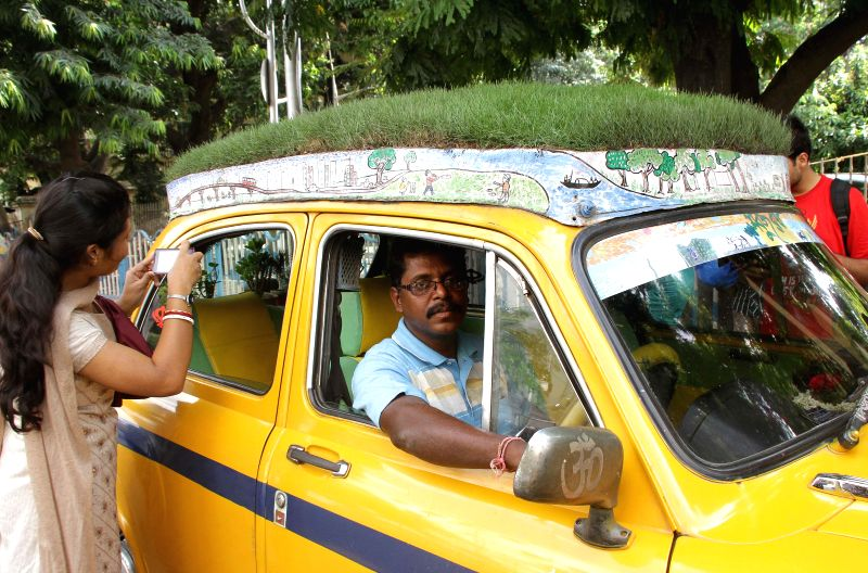 Dhananjoy Chakraborty, a Kolkata taxi driver in a bid to spread awareness regarding protection of environment turns his vehicle into a mobile garden. The vehicle has a grass bed on the roof and ... - Dhananjoy Chakraborty