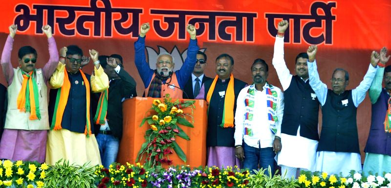 Prime Minister Narendra Modi and other BJP leaders during a rally at Dhanbad Airport Ground in Dhanbad, Jharkhand on Dec 9, 2014. - Narendra Modi