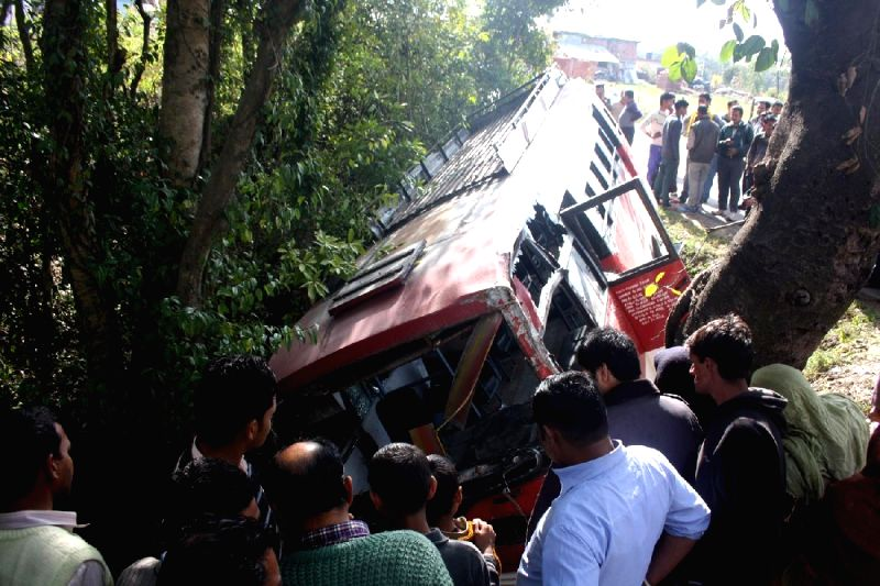 A view of the private bus that fell into a gorge near Tang, Dharamsala on March 13, 2015.