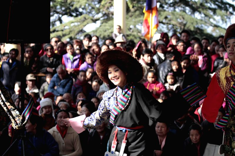 An artist performs during a cultural programe organised to mark the 25th anniversary of Nobel Peace Prize to Dalai Lama the spiritual head of Tibetan Buddhists at Tsuglakhang, the main ...