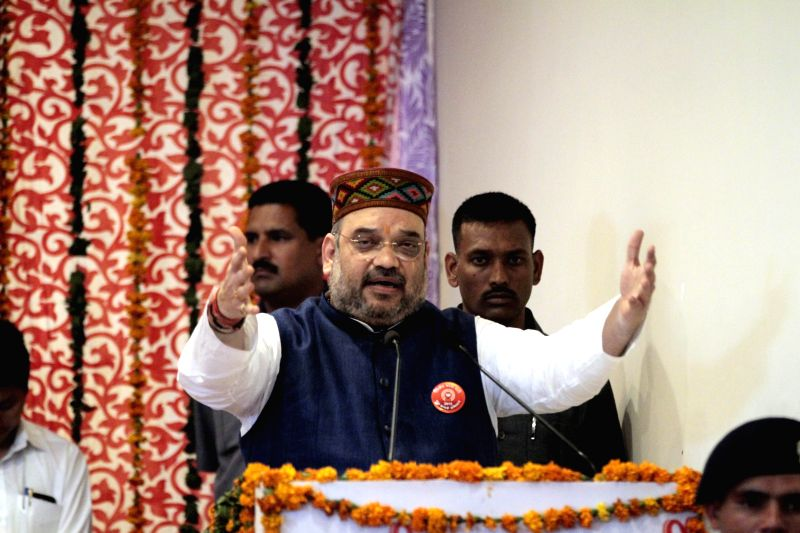 BJP chief Amit Shah addresses at a party meeting in Dharamsala on May 1, 2015.
