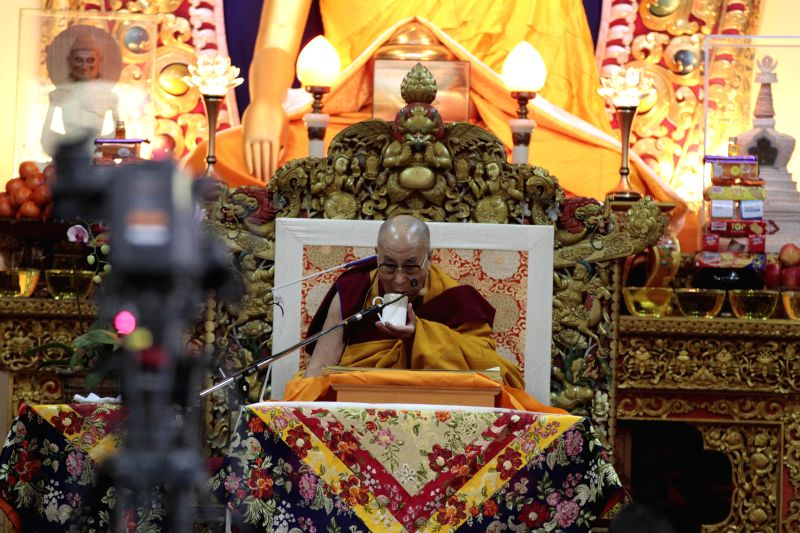 Dalai Lama the spiritual head of Tibetan Buddhists sips Tibetan tea during a preaching session at  Tsuglakhang, the main Tibetan temple in McLeodganj, Dharamsala on Dec 2, 2014.