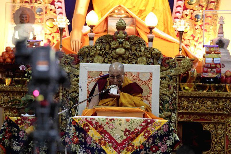 Dalai Lama the spiritual head of Tibetan Buddhists sips Tibetan tea during a preaching session at  Tsuglakhang, the main Tibetan temple in McLeodganj, Dharamsala on Dec 2, 2014.
