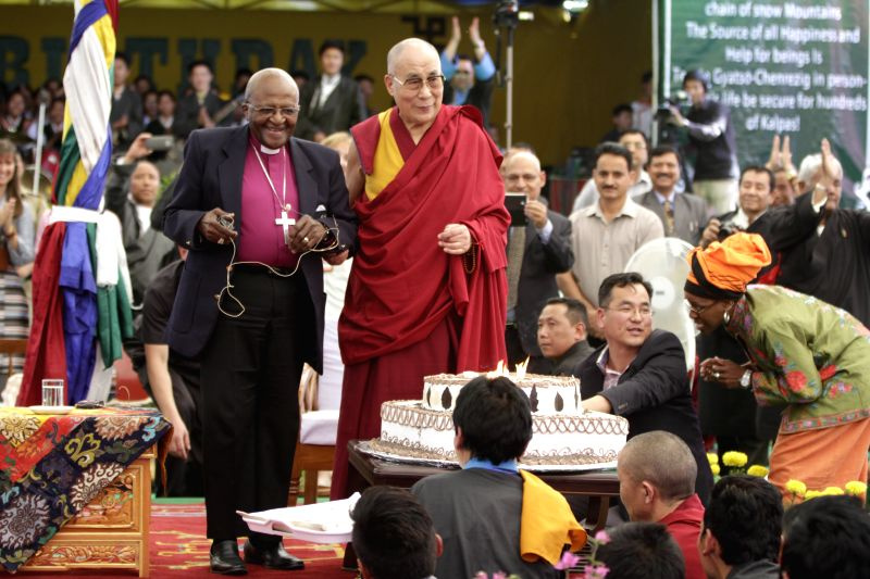 Tibetan spiritual leader the Dalai Lama celebrates his birthday with Archbishop Desmond Tutu in Dharamsala of Himachal Pradesh on April 23, 2015.