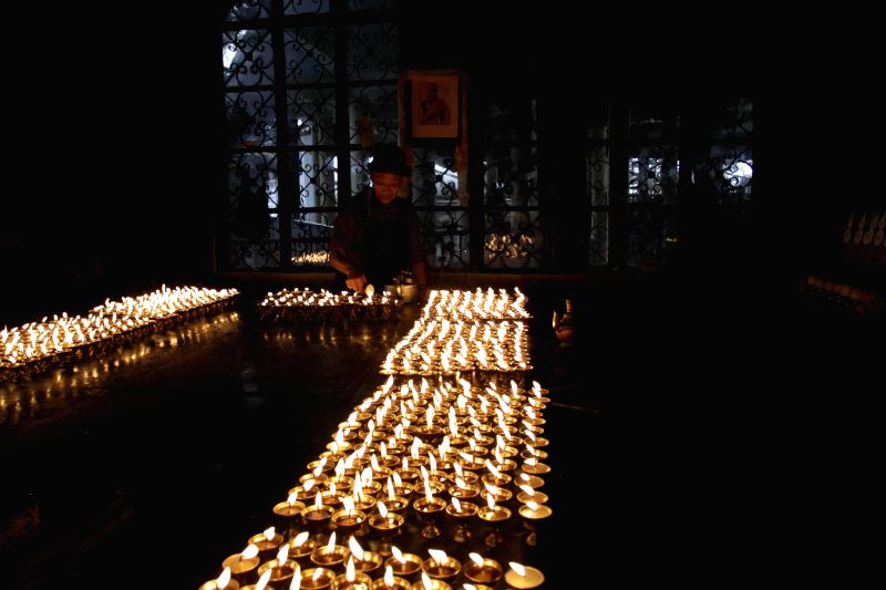 Tibetan women light lamps on Losar festival - the Tibetan New Year at Tsugla Khang temple in Mcleodganj, Dharamsala on Feb 19, 2015.