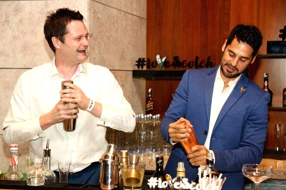 Diageo Brand Ambassador Nicholas Ord sharing bartending tips with Dino M...