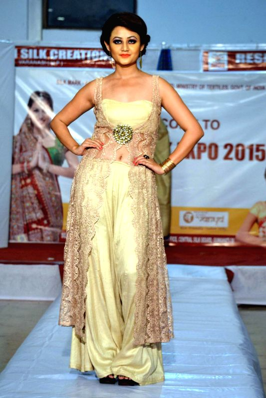 A model walks the ramp during a fashion show in Dibrugarh of Assam on March 14, 2015.