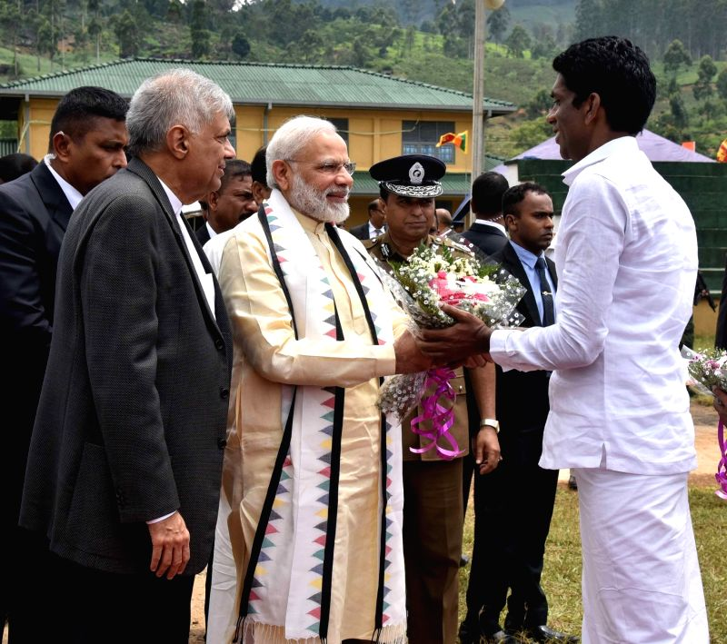 Dickoya (Sri Lanka): Prime Minister Narendra Modi being welcomed at the Indian origin Tamil Community function in Dickoya, Sri Lanka on May 12, 2017. Also seen Sri Lankan Prime Minister Ranil ... - Narendra Modi