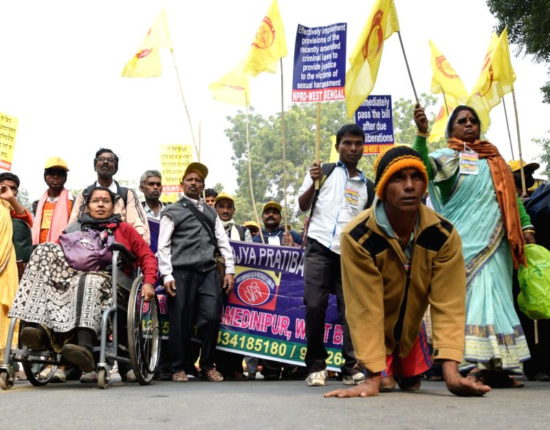 Differently-abled participate in a rally organised to observe World Disability Day at Jantar Mantar in New Delhi on Dec 3, 2015.
