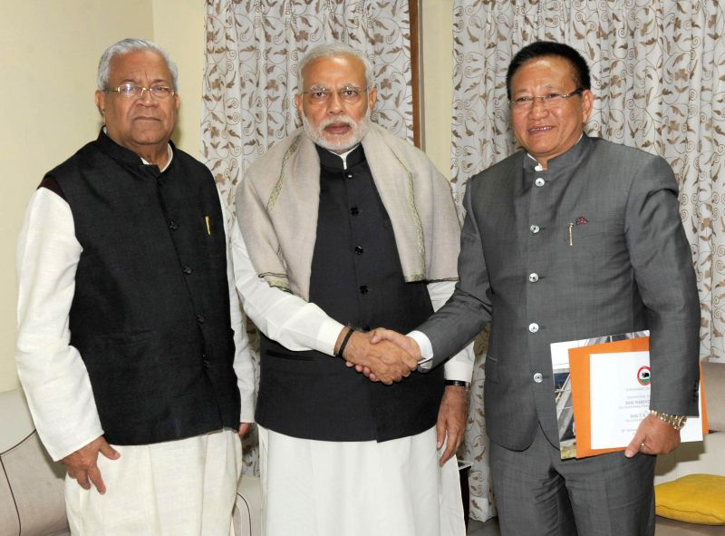 Nagaland Governor P.B. Acharya and Chief Minister T.R. Zeliang call on the Prime Minister Narendra Modi, in Dimapur, Nagaland on Nov 30, 2014. (Photo : IANS/PIB) - T. and Narendra Modi