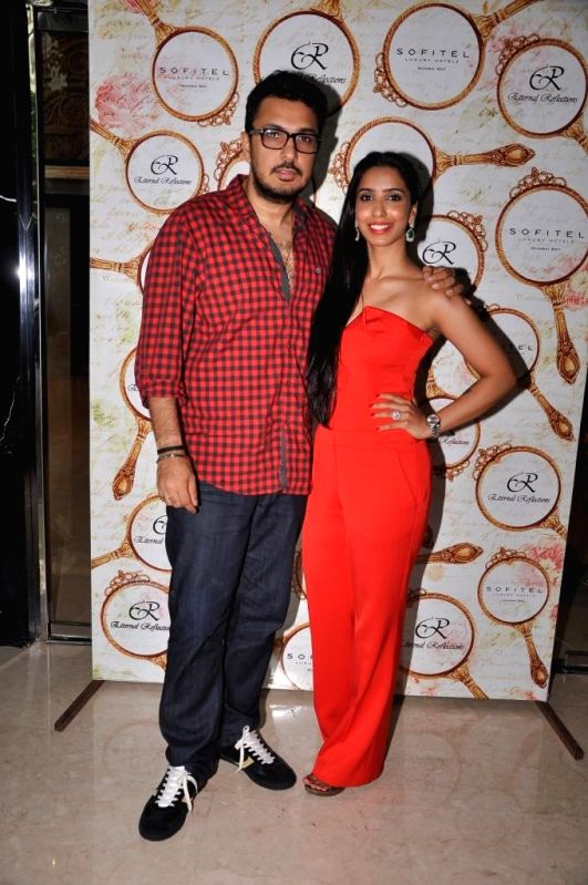 Dinesh Vijan with Pooja Vijan Gurnani during the High Tea Jewellery Preview in Mumbai on July 5, 2014.