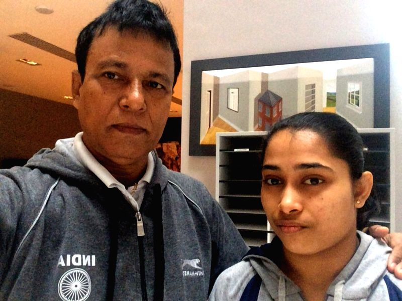 Dipa Karmakar with her coach in Glasgow Oct 29, 2015. The 22-year-old made history after becoming the first Indian to qualify for the finals of World Gymnastics Championships.