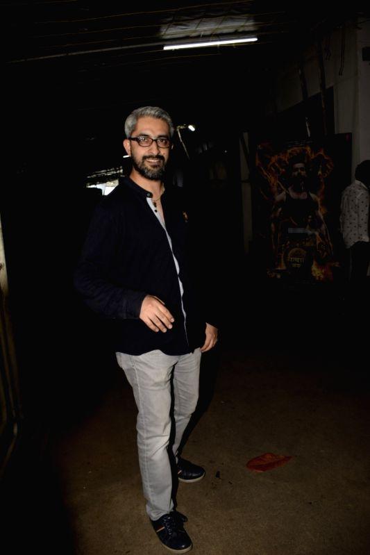 "Director Abhishek Sharma during the screening of upcoming film ""Satyamev Jayate"" in Mumbai on Aug 11, 2018. - Abhishek Sharma"