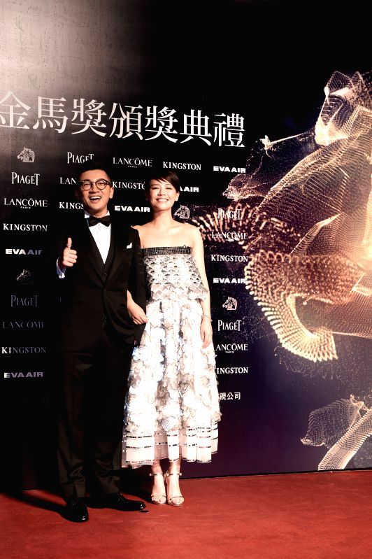"Director Alec Su and actress Sandra of movie ""The Left Ear"" arrive for the 52nd Golden Horse Awards in Taipei, southeast China's Taiwan, Nov. 21, 2015. The ... - Sandra"