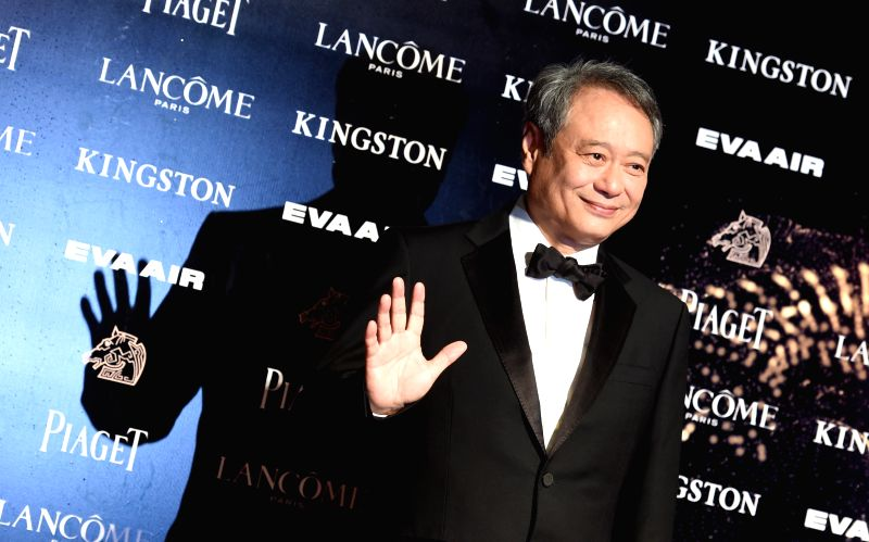 Director Ang Lee arrives for the 52nd Golden Horse Awards as an awarding guest in Taipei, southeast China's Taiwan, Nov. 21, 2015. The awarding ceremony of the 52nd ...