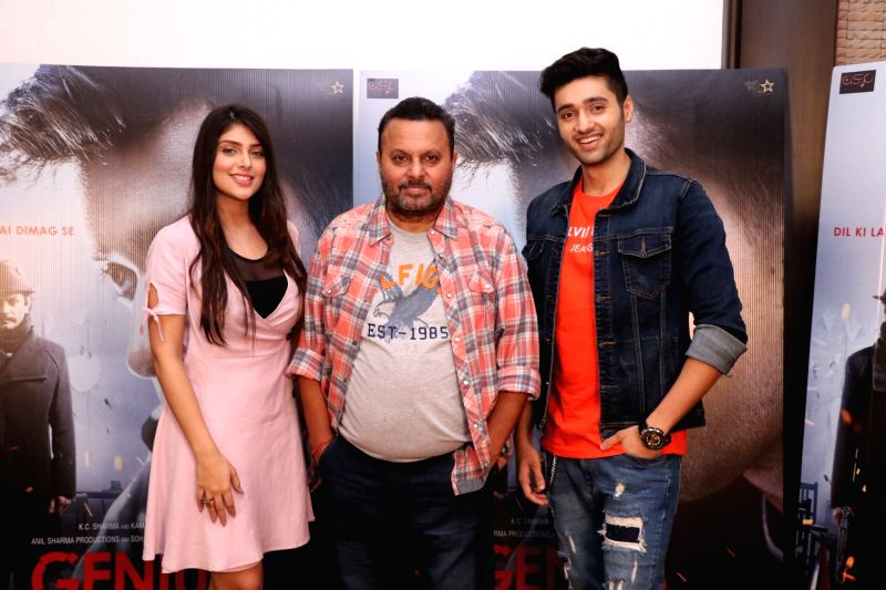 "Director Anil Sharma, actors Utkarsh Sharma and Ishita Chauhan during the promotion of their upcoming film ""Genius"" in Mumbai on Aug 10, 2018. - Utkarsh Sharma and Ishita Chauhan"