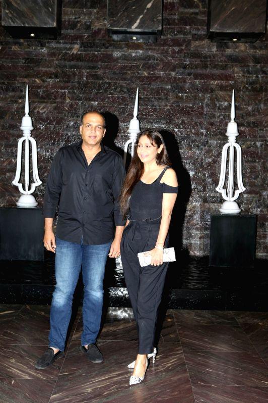 Director Ashutosh Gowariker along with his wife Sunita Gowariker at actress Kiara Advani birthday celebration in Mumbai on July 30, 2018. - Kiara Advani
