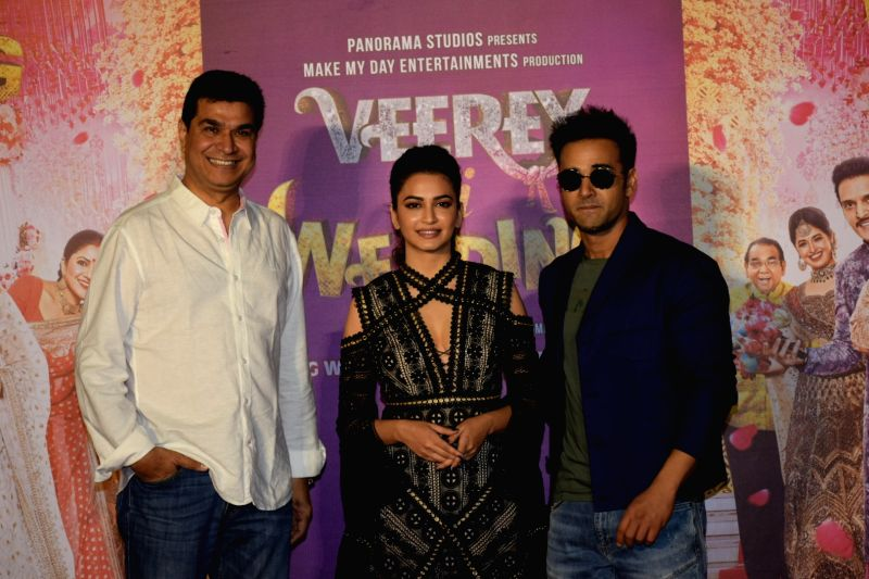 "Director Asshu Trikha, actors Pulkit Samrat and Kriti Kharbanda at the trailer launch of their upcoming film ""Veerey Ki Weeding"" in Mumbai on Feb 1, 2018. - Pulkit Samrat and Kriti Kharbanda"