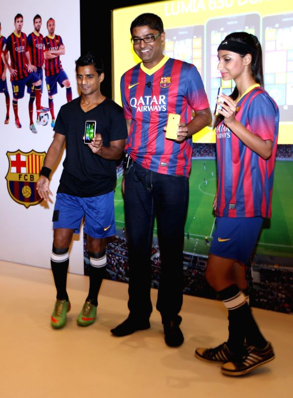 Director, East, Nokia India Kisley Kumar  along with East Bengal Club footballer Mehatab Hussain during the launch of Nokia Lumia 630 in Kolkata on June 17, 2014. - Kisley Kumar