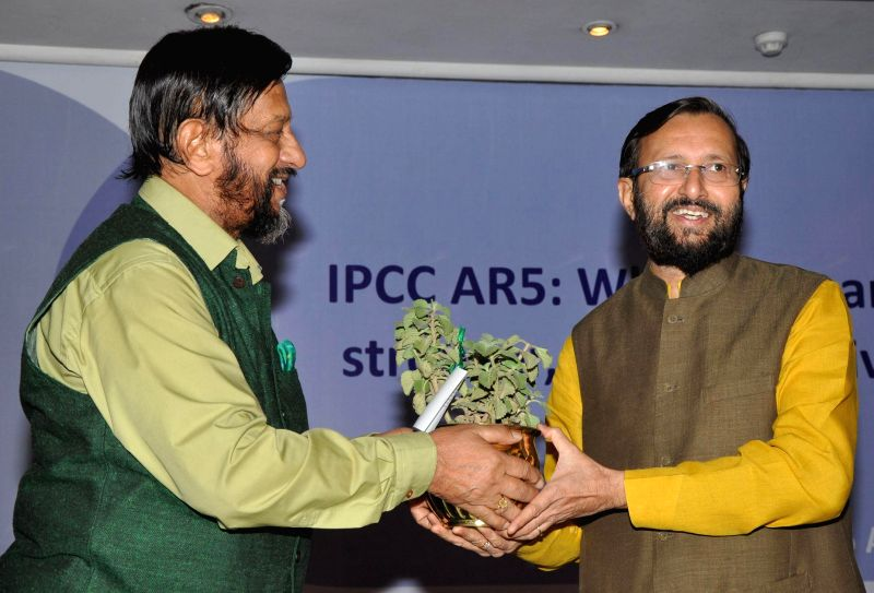 Director general of TERI R.K. Pachauri with the Minister of State for Information and Broadcasting (Independent Charge), Environment, Forest and Climate Change (Independent Charge) and Parliamentary .