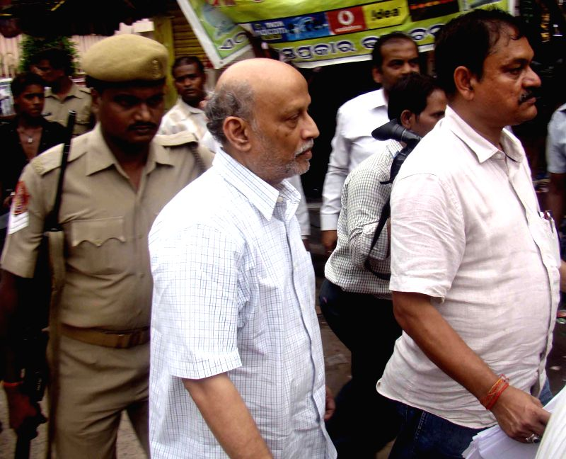 Director of a Vishakhapatnam-based hospital N.Prabhakar Babu being taken to be produced at SDJM court in connection with illegal kidney transplant at his hospital, in Cuttack on July 4, 2014.