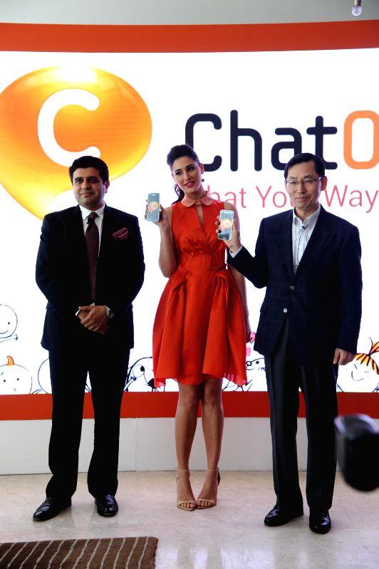 Director of Media Solutions Center- South West Asia Samsung Electronics Tarun Malik, actress Nargis Fakri and Samsung South West Asia President and CEO B.D Park during the launch of a social ... - Malik