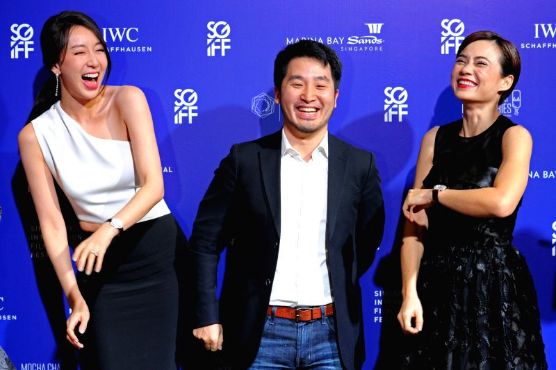 "Director of movie ""The Laundryman"" Lee Chung (C), actress Sonia Sui Tang (L) and actress Yeo Yann Yann attend the opening ceremony of the 26th Singapore ... - Sonia Sui Tang"