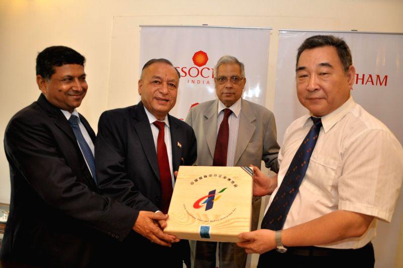Director of Small and Medium Enterprises Bureau of Guangdong Province, Wu Xiaochun with ASSOCHAM Micro Finance Committee chairman S.C. Aggarwal, Babu Lal Jain of World BPO Forum and ASSOCHAM ... - Lal Jain