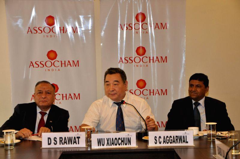 Director of Small and Medium Enterprises Bureau of Guangdong Province, Wu Xiaochun (C) addresses during a programme organised by ASSOCHAM in New Delhi on Aug 27, 2014. Also seen ASSOCHAM Secretary ...