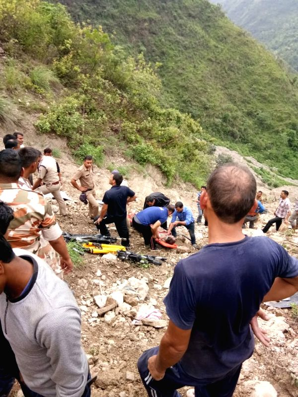 Disaster response personnel rescues an accident victim when a state-run bus fell into a deep gorge around 15 km from Chamba town in Tehri district on July 19, 2018.