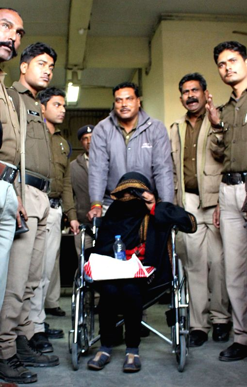 Dismissed IAS officer Tinoo Joshi (on wheelchair) being taken to jail from a Bhopal district court after the court rejected her bail plea on Jan 13, 2015. - Tinoo Joshi