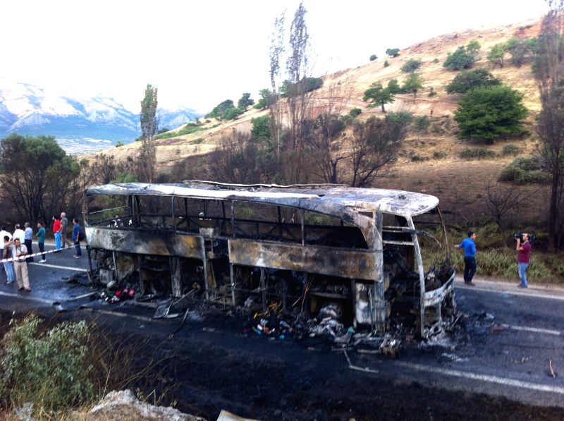 Photo taken on July 22, 2014, shows a burnt bus after a fuel tanker explosion in southeastern Diyarbakir province of Turkey. About 70 people were injured in an ..