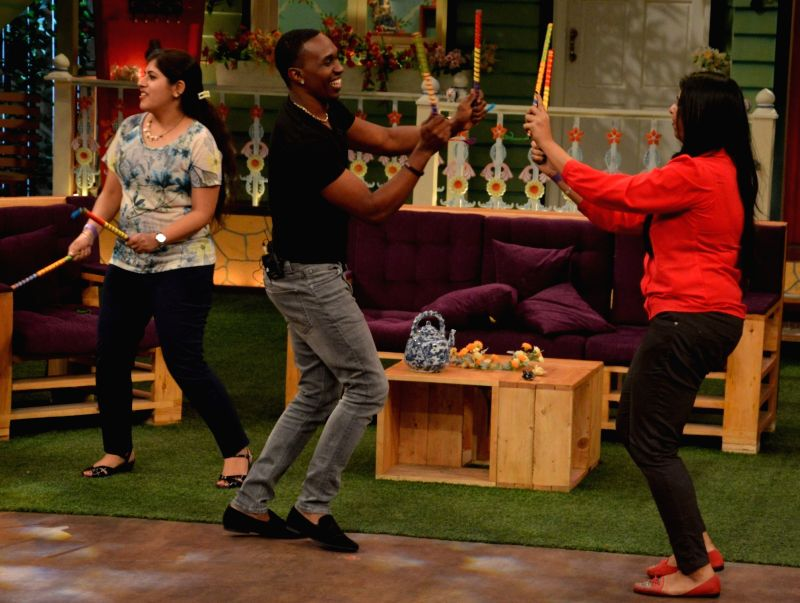 DJ Dwayne Bravo playing dandiya on the sets of Sony Entertainment Television`s The Kapil Sharma Show, in Mumbai on May 16, 2016.