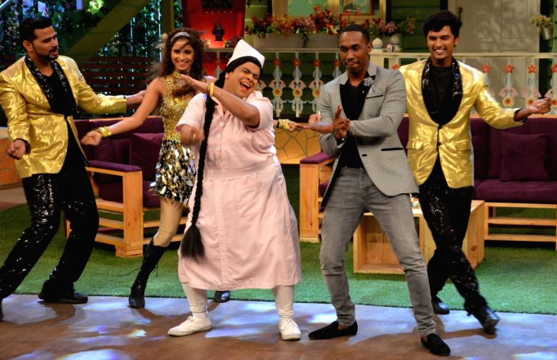 DJ Dwayne Bravo with Bumper Lottery (Kiku Sharda) on the sets of Sony Entertainment Television`s The Kapil Sharma Show, in Mumbai on May 16, 2016.