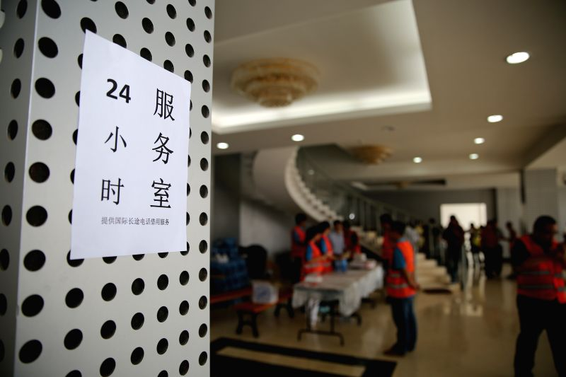 Vorlunteers work at a 24-hours service room at the temporary rest center in Hassan Gouled in Djibouti, March 31, 2015. More than 500 Chinese evacuees from ...