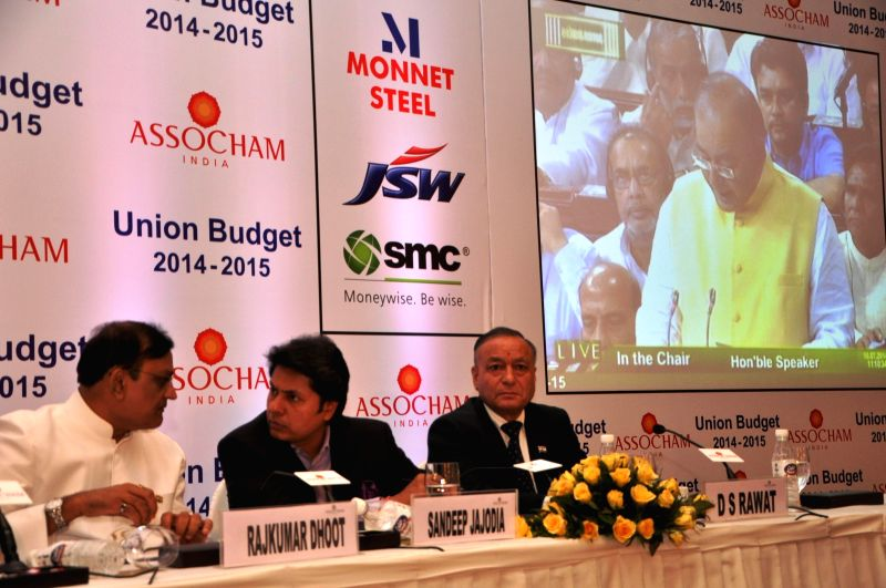 DLF Limited Group Executive Director Rajeev Talwar, Raheja Developers Private Limited MD Navin M. Raheja and other businessmen during ASSOCHAM Interactive Session in New Delhi on July 10, 2014.