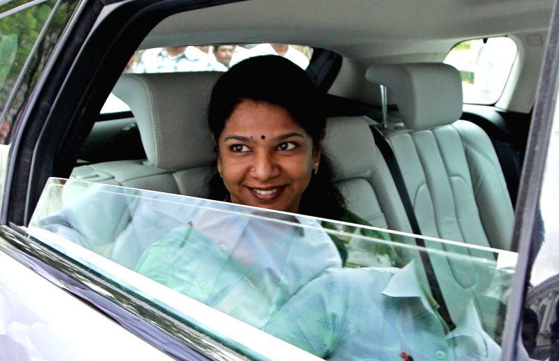 DMK Chief Minister M Karunanidhis daughter Kanimozhi and DMK Rajya Sabha Candidate Kanimozhi leaves the Secretariat, where Council of States Election 2013 held,in Chennai on June 27, 2013.