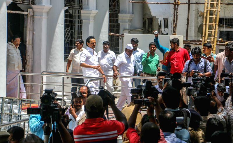 DMK legislators led by M. K. Stalin comes out of Tamil Nadu assembly after DMK legislators were sent out of the assembly they demanded a discussion on a television channel sting alleging ... - K. Palaniswami