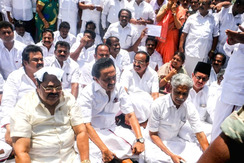 DMK legislators led by M. K. Stalin who were sent out of the Tamil Nadu assembly after they demanded a discussion on a television channel sting alleging money was paid for ruling party ... - K. Palaniswami